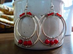 NICKEL FREE Wire wrapped silver hoops with red beads Via Etsy $14