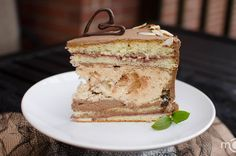 Kiev Cake _ This cake originated in Kiev, Ukraine, back in 1950's. Over the years it has gotten popular and now boasts a top choice among the favorite dishes of Ukraine, just like its few other siblings, Pelmeni and Poppy Seed Buns.