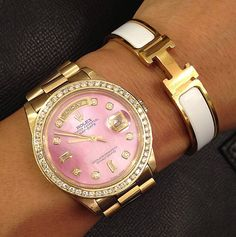 pink rolex and white hermes
