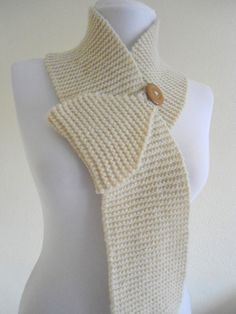 scarf. This would be a simple to do with garter stitch and decreased stitches on the end and loop for button