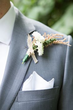 grooms boutonniere - photo by Somerby Jones Photography http://ruffledblog.com/herbes-de-provence-wedding-inspiration