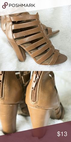Tan color sandle heels. Beautiful and comfortable. Couple scratches but not very noticeable. Shoes