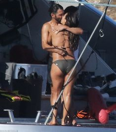 Passion: Clearly enjoying some special time away with her husband of just over a year, Jose Baston, the Overboard star was seen enjoying an extremely steamy smooch with her love