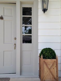 Siding is SW Pure White and the door is SW Dorian Gray. Lantern is Allen and Roth from Lowes