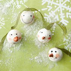 cover foam balls with air-dry clay, give each snowman a shaped nose, and paint on details for instant character.