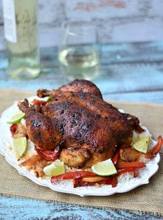 An aromatic, whole Peruvian Roasted Chicken served with rice for the perfect family night meal.