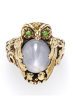 Arts & Crafts 14kt Gold, Star Sapphire, and Demantoid Garnet Owl Ring, Walton & Co., prong-set with an oval cabochon sapphire measuring approx. 11.50 x 9.50 x 6.20 mm and weighing approx. 7.00 cts., demantoid garnet eyes, size 6 1/4, signed.