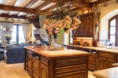 French Normandy Home - French Country Style Kitchen; Opens to the Family and Informal Dining Area