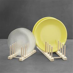 Wooden Plate Racks Display a collection of colorful or antique plates, or simply get organized in your china cupboard with the aid of these natural wood plate racks.