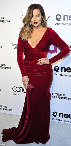 Khloe Kardashian looking gorgeous  in a Red Velvet form fitting evening gown