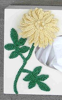 This free crochet flower pattern creates a pretty layered embellishment. This specific pattern shows how to use this flower pattern to embellish a kleenex box.
