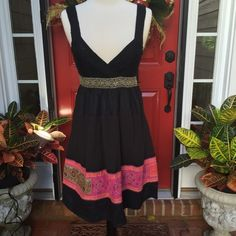 """Free People Dress Gorgeous little dress. Top is 30% wool and 70% acrylic, bottom is 100% cotton. Has band of needlepoint design on bottom. Bust is 28"""" with lots of stretch. Band underneath bust is 26"""" and length is 35 1/2"""". Free People Dresses"""