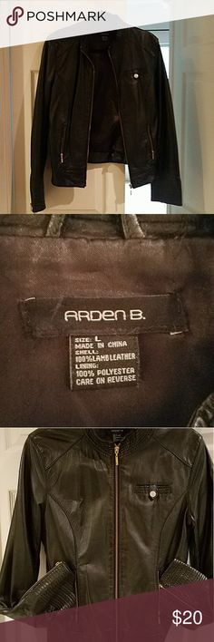 100% Lamb Leather Black Moto Jacket from Arden B 100% Leather Moto Jacket with lining and gold accents. Size L. Missing the leather tab that connects on the back of the jacket. In great condition, small scratch on arm (see pic for details). Has plenty of fall and winter seasons left. Arden B Jackets & Coats