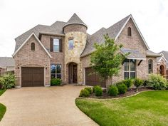 I love the exterior of this home here.  I love the round top entryway with the double garages.  This looks like a great home to raise a family in.  The community would have to be nice as well.