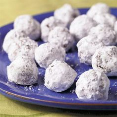 Bourbon Balls | Who spiked the cookies? Hardly a Christmas can pass in the South without these traditional ball-shaped, bourbon-flavored pecan cookies ending up on a dessert bar or in a gift box. | SouthernLiving.com