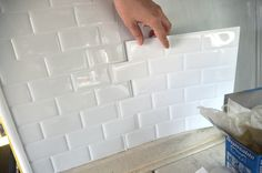 Peel and stick tiles to use in a kitchen or bathroom in a Tiny House - Easy installation and lightweight.