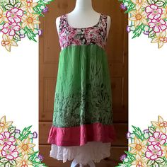 This is a pretty layered silk dress with stretch cotton top. Made from recycled clothing. Unique and one of a kind. A soft cotton knit top which sits just below the bust and floats out in two layers of delicate silks in soft green, pink and a cream silk petticoat lining. Measurements: Bust 38 - 44 ins Length 45 ins. Please CHECK your measurements carefully. Returns Policy: I do accept returns if you are not completely happy with your item. Please notify me within 7 days of receiving your…