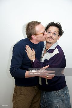 Paul Bettany and Johnny Depp at the 'Transcendence' Press Conference at the Four Seasons Hotel on April 6, 2014 in Beverly Hills, California.