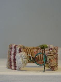 Kate Whitehead Textiles Hand Woven Bracelet Made from string,rags & tatters © 2015 Kate Whitehead