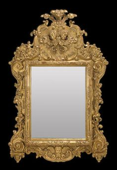 An Italian Rococo carved giltwood mirror mid-18th century
