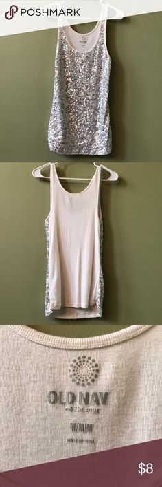"""Worn ONCE • SEQUIN Silver/White Tank Top • Medium Old Navy Sequin tank top with silver and white sequins WORN ONCE! • Size Medium, fitted • Sequins only on front  • Worn and washed only once, just missing the """"y"""" in Navy from it. Letters on label appear to be peeling.  • All sequins in tack, no snags or pulls • ADORABLE in the sun during the summer, especially at the beach!   🚫 No trades 🚫 No Lowball offers 🚭 Smoke Free Home  Will try to answer all questions to the best of my ability! Old…"""