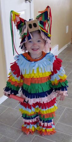 Cute child in DIY Pinata costume......wouldn't you be afraid some other little kid would try to beat the crap out of this one so the candy would spill out?!