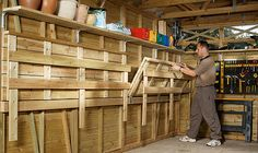 Love this!! DIY, pulldown workbench for the garage.