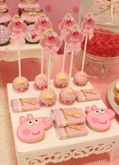 The cookies and cake pops at this Peppa Pig Birthday Party are so pretty! See more party ideas and share yours at CatchMyParty.com