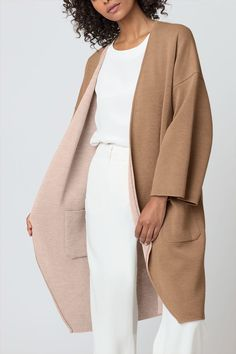 The humble cardigan is elevated by a tapestry of tailoring, knit craftsmanship and soft color. A modern classic, ours is cut in pure baby alpaca that is reversible and tailored to an oversized fit. The dropped shoulder seams graduate to a relaxed sleeve length intended to be cuffed for a two-tone appearance.