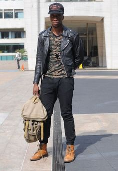 Camouflage shirt paired with leather jacket. Follow Sneak Outfitters for more cool street fashion snapshots from New York City. www.sneakoutfitters.com