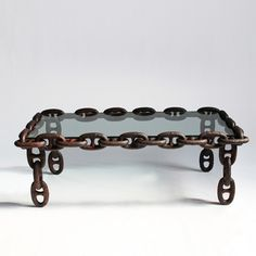 Antique solid iron ship chain repurposed into an interested coffee table with inset glass. $2100