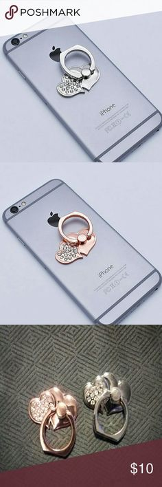 Double heart and rhinestone phone ring Double heart and rhinstone phone ring. Ring attaches to the back of your cell phone so it's easy to hold, text or take pics. Use as a phone kickstand also. Available in silver or rose gold. Price is for 1. I have 2 colors. Accessories Phone Cases