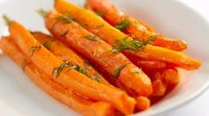 Not only are carrots delicious, one cup of the sliced veggie contains only 50 calories! Carrots are great for any weight loss diet because they're not as bitter as other vegetables. We love them as a side dish or as a raw appetizer or snack. Honey Carrots, Glazed Carrots, Roasted Root Vegetables, Roasted Carrots, Veggies, Ravioli, Low Calorie Recipes, Healthy Recipes, Veggie Recipes