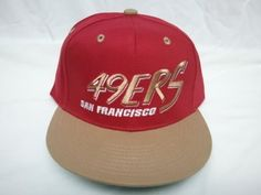 "NEW San Fransico 49ers NFL Two Tone Vintage Snapback Flatbill Cap / Hat by Reebok. $19.95. ""49ers San Francisco"" is very nicely embroidered on front panel of hat. 49ers logo embroidered on the back. This hat is Red with Light brown bill and green underbill."