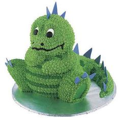 Cake - Dinosaur-loving kids will cheer when you serve this candy-scaled, spiky-tailed figure. Build the lizard from cakes baked in our Stand-Up Cuddly Bear Pan and Mini Wonder Mold Pan. Dinosaur Birthday Cakes, Dinosaur Party, Boy Birthday, Happy Birthday, Birthday Ideas, Dinosaur Cake Pan, Unique Birthday Cakes, Girl Dinosaur, Birthday Quotes
