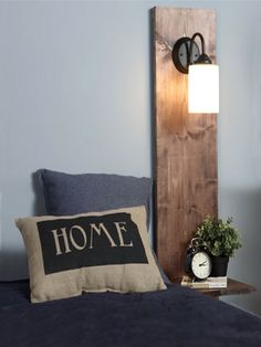This bedside table includes a wall light and is perfect if you are renting a home. The wires for the light are hidden behind the panel, and only a couple of fasteners are required at the back to mount the shelf