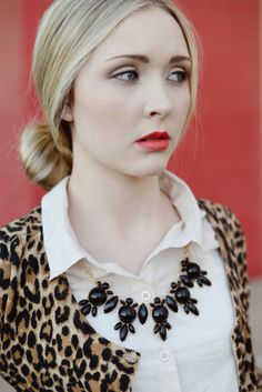 Love this sweater/necklace/blouse pairing.