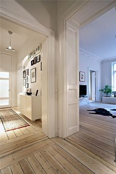 wood plank floors white walls- great casual wood planks. Now you can be a little more formal with the moldings..