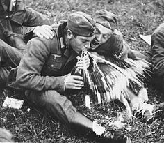 Two German soldiers drink champagne