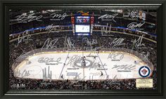 Winnipeg Jets team facsimile signatures picture framed and protected under glass.  This 12 in. x 20 in. gloss image shows MTS Centre NHL Arena, reproduced in limited edition.