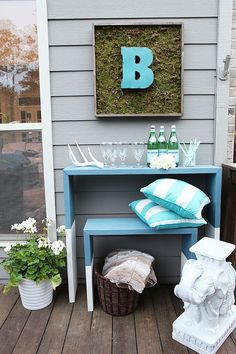 We love this corner of Katie Bower's backyard deck. Nesting tables provide function, and DIY moss art provides fun. See more of this easy deck makeover by the blogger behind Bower Power. It's on The Home Depot Blog.    @katiebower