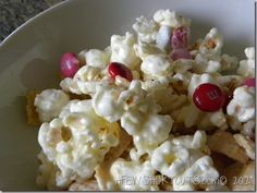 White chocolate popcorn - use different colored M&M;'s for different holidays.