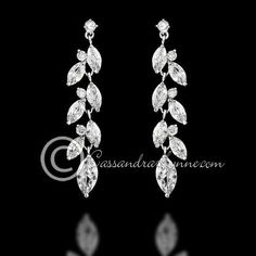 CZ wedding earrings in a vine drop design of marquise jewels. Post back, 1.75 inches long and 3/8 of an inch wide.They areavailable in rhodium silver, gold an