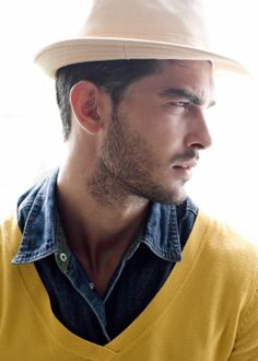 ivory hat, chambray shirt, yellow sweater...what does wear on the bottom?