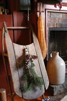 Old Wooden Sled with Pine & Cones...olde crock jug by the fireplace.