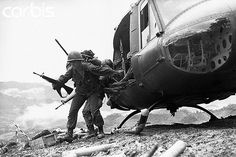 """18 May 1969, A Shau Valley, South Vietnam --- Paratroopers jump out from a helicopter to assist in fighting at Dong Ap Bia, which became known as """"Hamburger Hill"""" in the A Shau Valley in South Vietnam on May 18, 1969.  The battle lasted 10 days for the Army of the Republic of Vietnam and the U.S. 101st Airborne Division fighting against the North Vietnamese Army resulting in heavy casualties for all. --- Image by © Bettmann/CORBIS"""