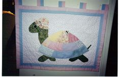 Wouldn't your new Mom love this in the nursery?  You can make it at The Needle Arts Center.