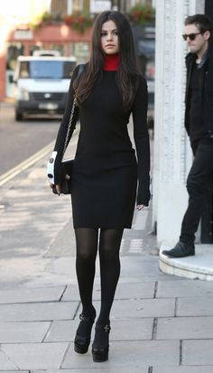 Selena Gomez wears an Edun dress with Brian Atwood heels and a Louis Vuitton bag.