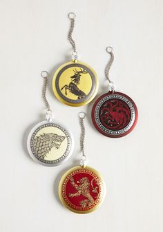 Your decor will be the realm's most legendary once you adorn the tree with this Game of Thrones ornament set. Emblazoned with a noble coat of arms on one side and the family's name and motto on the other, this quartet of round, lightweight adornments pays homage to each of the Great Houses - Baratheon, Lannister, Stark, and Targaryen!