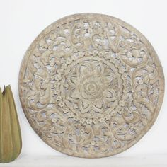 A detailed carving of the Lotus theme in a smaller round size. Several recycled rough-hewn teak planks from old dwellings community buildings joined together then carved as a single unit.